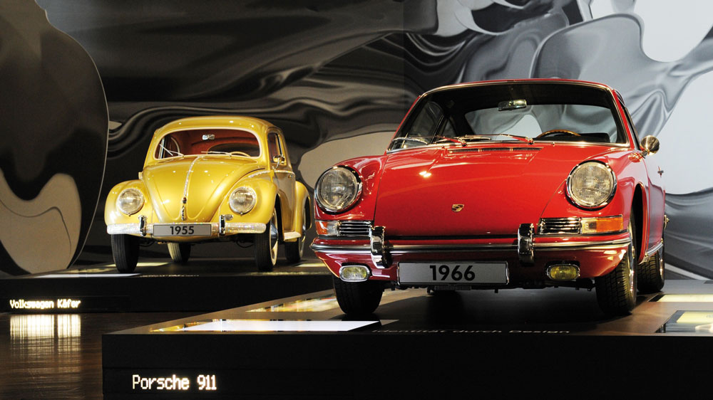 A VW Beetle (L) from 1955 and a Porsche 911 built in 1966 - PH: Press Association