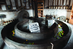An old-fashioned cider press – Aspall has only recently switched to modern manufacturing equipment
