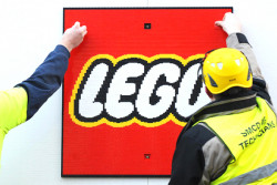 Lego's parent company has bought back the entertainments company it sold to Merlin Entertainment in 2005